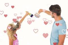 年轻夫妇绘画的综合图象与刷子的 免版税图库摄影