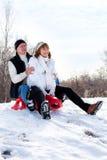 夫妇sledding 库存照片