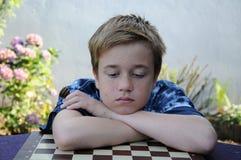 失望的下象棋者 免版税库存照片
