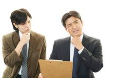 失望的亚洲商人 免版税库存照片