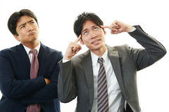 失望的亚洲商人 免版税图库摄影