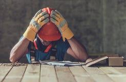 失望的哀伤的承包商 免版税库存图片