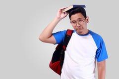 失望的年轻亚裔男学生 库存照片