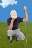 失望的高尔夫球运动员 免版税库存图片