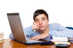 失败的计算机了解少年的男学生 库存照片