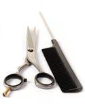 头发剪刀和梳子 免版税库存图片