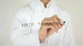 头发移植,写在玻璃 免版税图库摄影