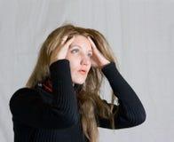 头疼妇女 图库摄影