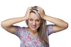 头疼青少年的妇女 库存图片