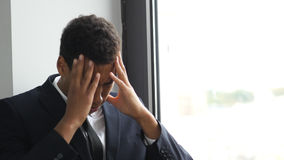 头疼,在问题的商人,认为为解答 免版税库存照片