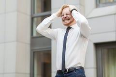 头疼 商人有问题或重音 库存图片