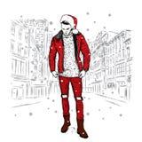 夹克、牛仔裤和圣诞节帽子的一个时髦的人 也corel凹道例证向量 新年` s和圣诞节 免版税库存图片
