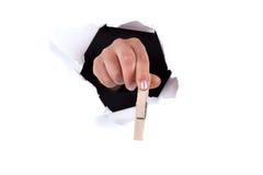 夹子通过墙壁妇女递藏品漏洞 免版税库存图片
