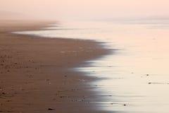 奇怪大气的海滩 免版税库存照片