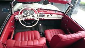 奔驰车190SL红色皮革内部 免版税图库摄影