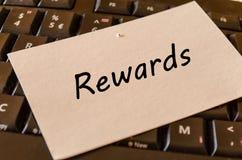 奖励在键盘背景的概念 免版税库存图片