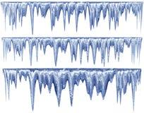 套一片蓝色树荫的垂悬的解冻冰柱 库存图片