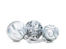 套三个银色圣诞节球 库存图片