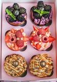 套不同的可口杯形蛋糕 免版税库存图片