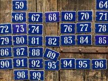 套不同的房子号码板材 库存照片