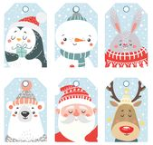 套与动物和圣诞老人的圣诞节和新年标签 库存图片