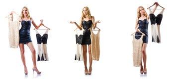 套与尝试新的衣物的妇女的照片 免版税库存图片