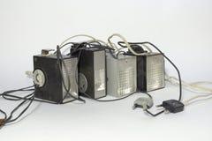 套与热的鞋子的葡萄酒电子脉冲照相机闪光 免版税库存图片