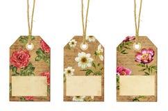 套与花的葡萄酒标记 免版税库存图片