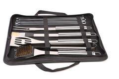 套为bbq的工具在黑袋子。 免版税库存图片