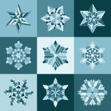 套九个传染媒介蓝色白色雪花形状设计元素 免版税库存照片