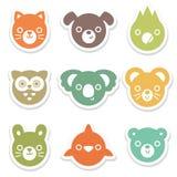 套五颜六色的动物和鸟面孔贴纸 免版税库存照片