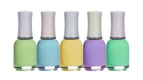套五颜六色的在白色隔绝的春天淡色指甲油 免版税库存照片