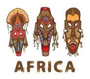套传统非洲面具 装饰题字非洲 图库摄影