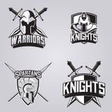 套体育队的现代专业商标 战士、骑士和spartans吉祥人导航在黑暗的背景的标志 库存图片
