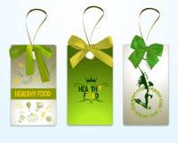 套健康食物用绿色丝绸丝带标记 免版税库存照片
