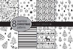 套八个无缝的手拉的圣诞节样式 免版税库存图片