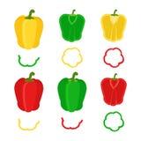 套切好的红色,黄色,绿色甜椒 平的样式 免版税库存图片