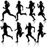套剪影。短跑的赛跑者,妇女。 库存图片