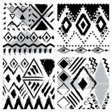套四个黑白手拉的部族无缝的样式 免版税图库摄影
