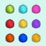 套圣诞节色的装饰球 免版税库存图片