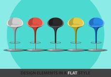 套在一个平的样式的色的凳子 图库摄影