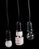 套在容器的三个电灯在黑色 免版税库存照片