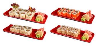 套在红色板材的寿司卷 库存照片