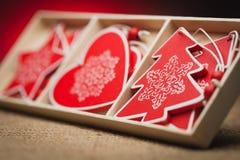 套在红色背景的圣诞节装饰 免版税图库摄影