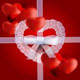套在红色背景的心脏 免版税库存图片