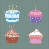 套在软的颜色的四个鲜美杯子蛋糕 库存照片