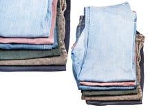 套堆各种各样的牛仔裤和条绒 免版税库存图片