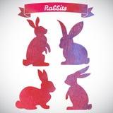 套复活节兔子手拉的剪影和水彩llustrat 库存图片