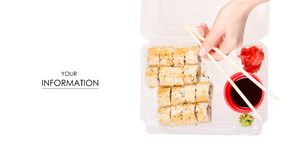 套寿司手中姜山葵酱油样式的卷筷子 库存图片