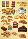套手图画蛋糕和曲奇饼 免版税库存图片
